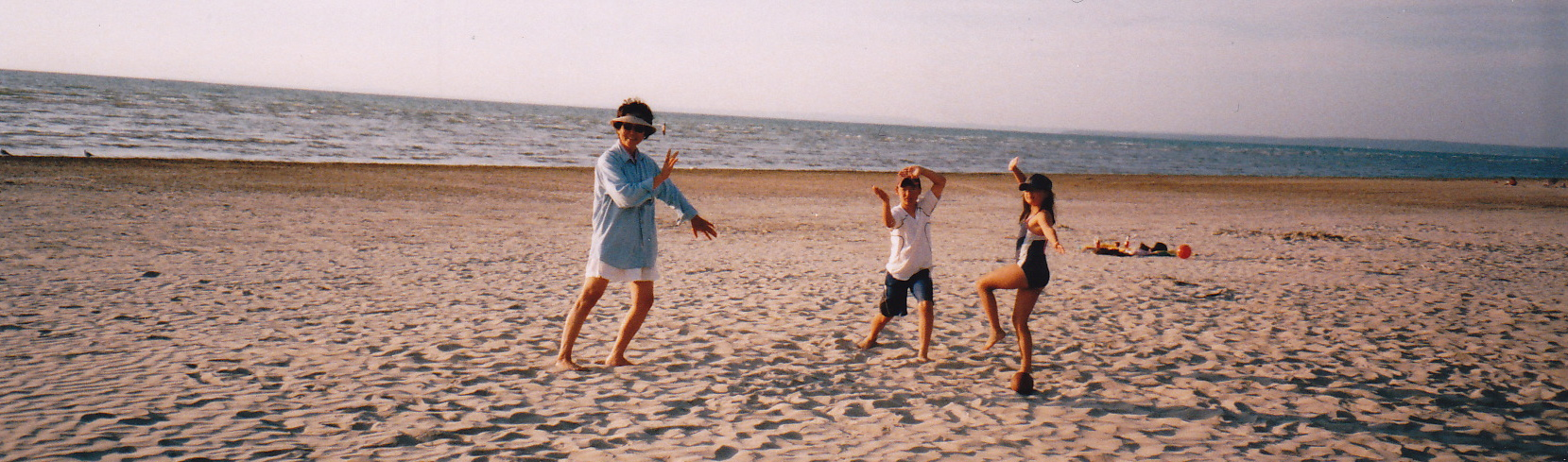 picture of people doing TaiChi on the beach